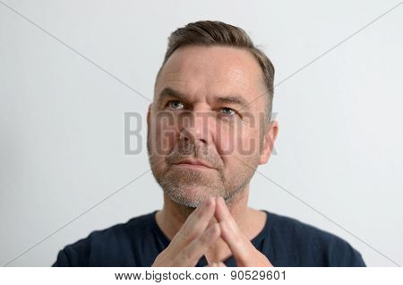 Attractive Middle Age Man With Folded Hands