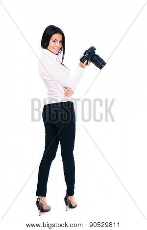 Back view portrait of a happy woman photographer looking at camera. Isolated on a white background