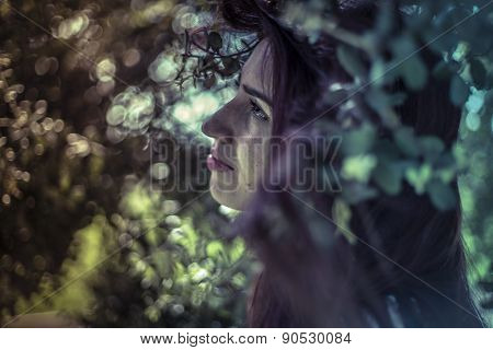 Tears, melancholy young girl in a forest with sad gesture
