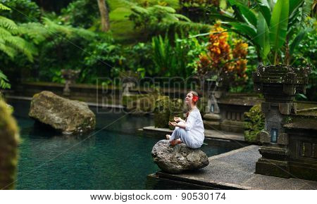 Panorama pf young woman doing yoga outdoors in tranquil environment