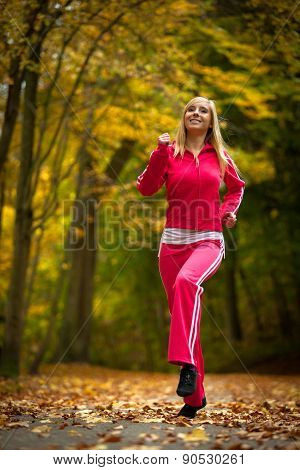 Fitness Fit Woman Blond Girl Doing Exercise In Autumnal Park. Sport.