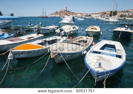 Moored Boats With Town Of Rovinj In Background