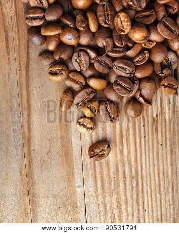 Coffee beans on grunge wooden surface top view  background