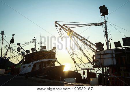 Ships Moored At Dock In Rovinj At Sunset