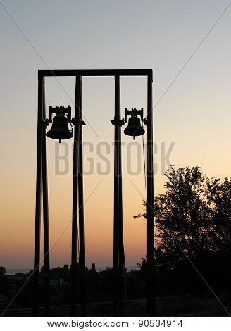 Silhouette Of Church Bells On Sunset