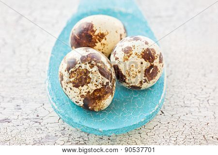 Quail Eggs On A Blue Wooden Spoon, Macro