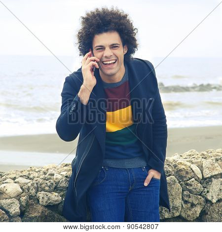 Happy Cool Man Smiling Talking On The Phone In Front Of The Ocean Retro Style