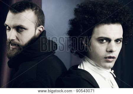 Two Elegant Handsome Vampires Looking Camera