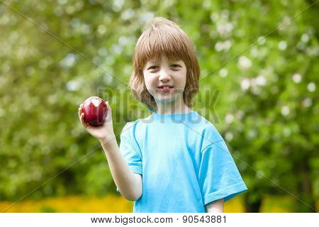 Boy With Red Apple Showing Heart Shaped Bite Off