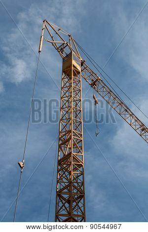 Tower Crane Against The Blue Sky