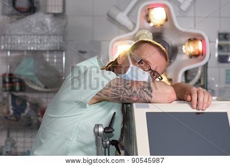 Portrait Of  Male Nurse Icu  With Tattoo And Dreadlocks.