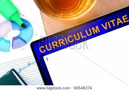 Words curriculum vitae   cv on the tablet and charts.