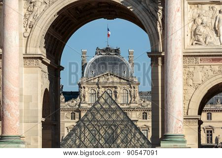 Paris - Triumphal Arch and Glass Pyramid in Louvre.