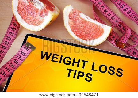 Tablet with weight loss tips.