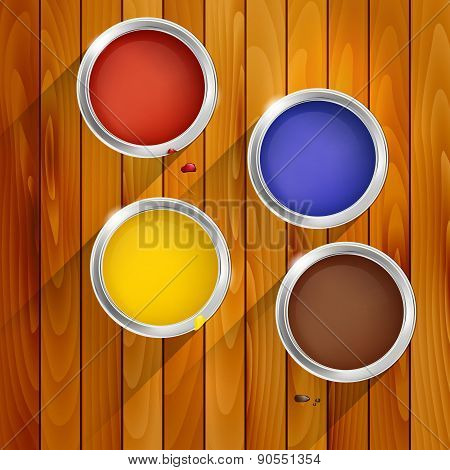 Cans Of Paint On A Wooden Background