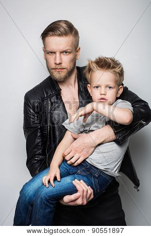 The portrait of a little boy and his father. Fathers day