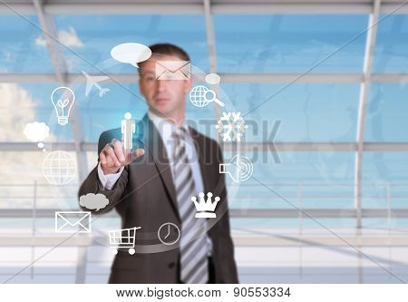 Businessman pressing on holographic screen
