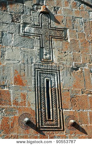 Carved Cross In Stone. Detail On The Wall Of An Abandoned Georgian Orthodox Church