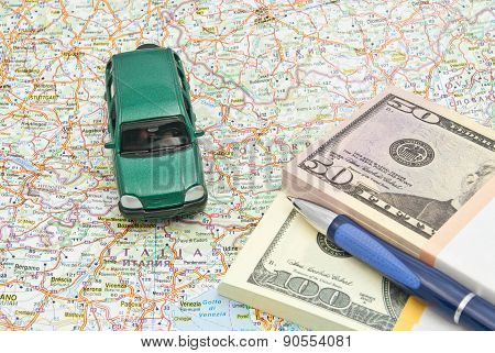 Money, Pen And Green Car On Map