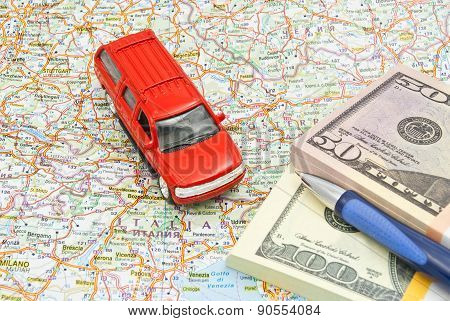 Money, Pen And Red Car On Map