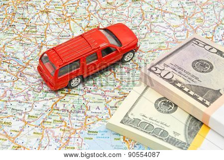 Money And Red Car On Map