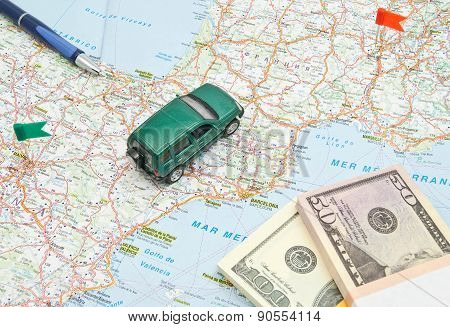 Green Car, Pen And Money On Map