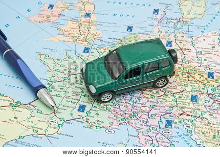 Green Car And Pen On Map