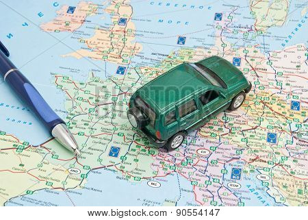Green Car And Pen On The Map