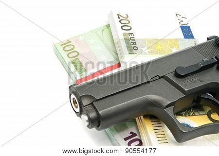 Gun And Banknotes On White