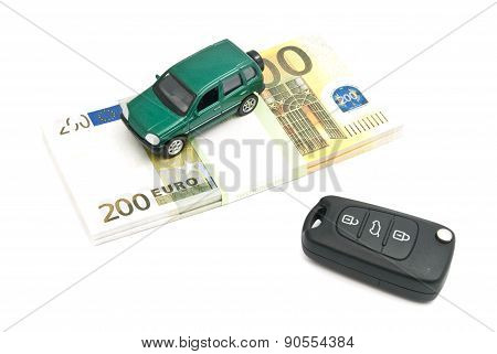 Keys, Green Car And Banknotes