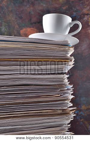 Cup On A Pile Of Papers