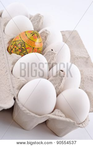 Easter Egg And Jast Eggs In A Cardboard Box