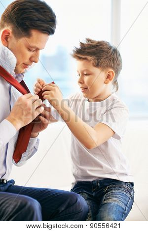 Father and son getting dressed