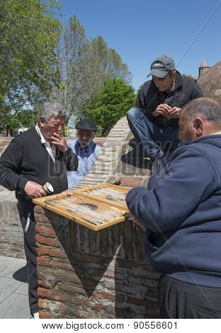 TBILISI, GEORGIA - MAY 02, 2015: Men playing backgammon on the street