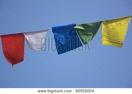 Prayer Flags against a Blue Sky