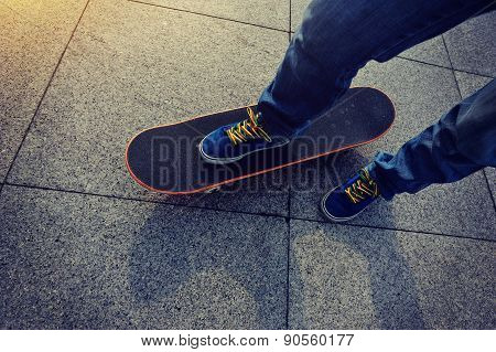 skateboarder legs and skateboard