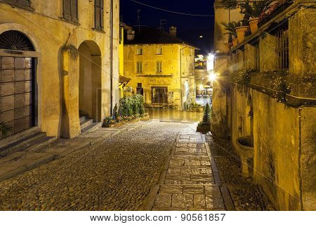 Orta San Giulio old city, night view. Color image