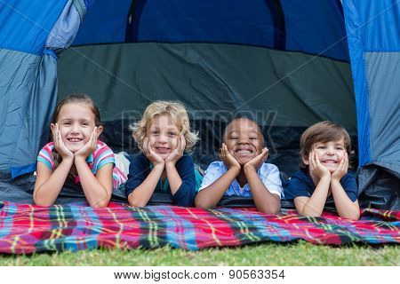Happy siblings on a camping trip on a sunny day