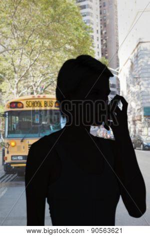 Blonde woman taking her inhaler against school bus in city