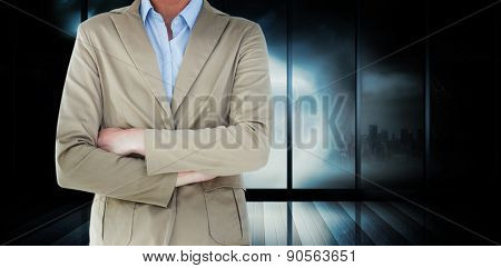 Businesswoman in suit smiling at camera against room with large window looking on city