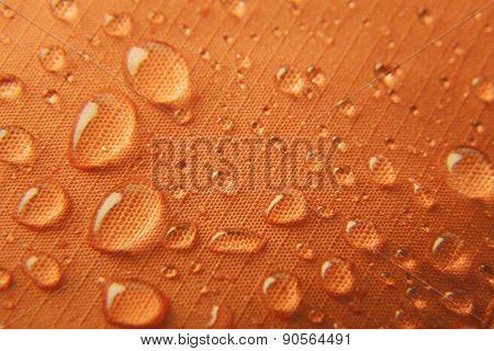 Orange waterproof textile background \ horizontal