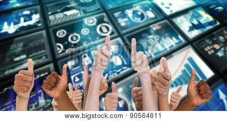Hands showing thumbs up against screen collage showing business images