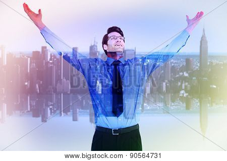 Cheering businessman with his arms raised up against mirror image of city skyline