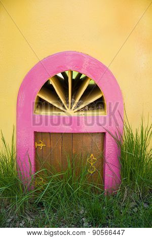The Little Door In A Yellow Wall And Green Grass