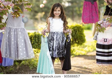 Little Girl Choosing Clothes