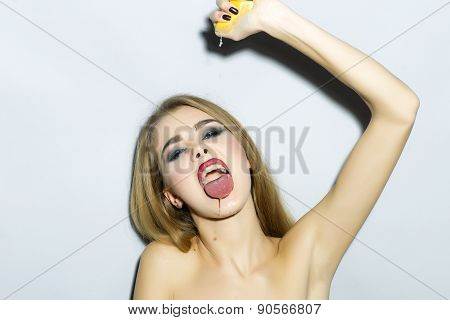 Impassioned Blonde Young Woman Portrait With Orange
