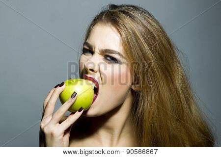 Cruel Sexy Blonde Girl With Apple