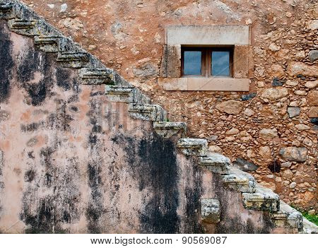 Abstract Of A Brown Stone Wall With Window And Stairs