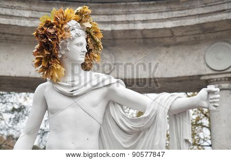 Sculpture Wearing A Wreath Of Leaves