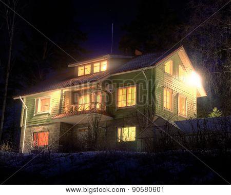 Cottage At Winter Night